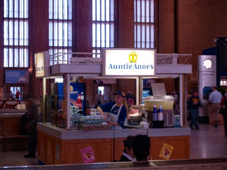 The lady is standing near the door to the Auntie Anne's kiosk. Best pretzels ever.