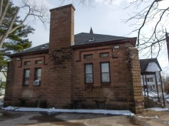 North side of the social hall - I like how they made cement block look like brownstone.