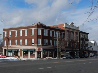 Comstock Hall - The two buildings are joined by a continuous first-floor storefront cornice, but the 1899 structure is taller and has a more elaborate classical revival design.