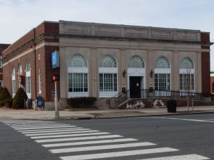 """East Hartford Trust Company. The little red box in between the windows on the left side says """"Vault Alarm."""""""