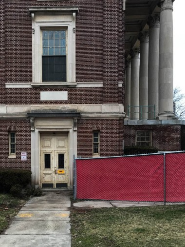 This building is under construction. I've featured the main doors before, but I like this side door.