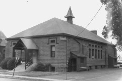 NRHP - Church hall, built from precast block, but with the look of brownstone and in the Victorian Gothic Style, including corner butresses and butresses near the windows, and a similar tower.