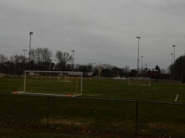 The soccer goals have been set up and the fields are getting green.