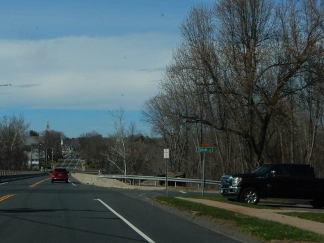 The truck on the right is parked at the bar. The tall steeple above the trees on the left is St. Joseph's.