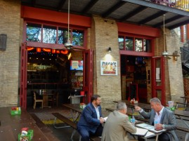 Most of the bars have folding doors to let them have an indoor/outdoor flow.