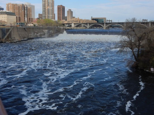 St. Anthony's Falls from the center of the Stone Arch Bridge. The lock structure is on the left.