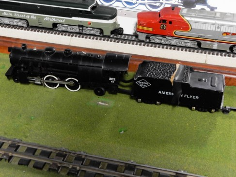 My brother used to have this engine and coal car in his American Flyer train set.