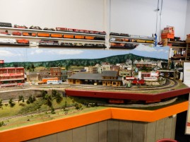 This is the opposite side of the downtown layout. Notice the trains on the wall, ready to roll.