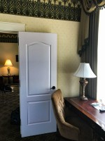 Writing desk by the door of the bedroom.