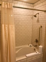 A sower curtain might not be a door, but I wanted to include a picture of the bathroom. Modern fixtures, historic appearance.