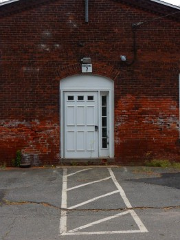 Unfortunately, they have fitted a few modern doors into the old entrances.