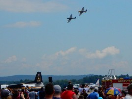 That's a WWII Spitfire being chased by a WWII era P-51 - the Great New England Air Show.