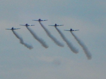 GEICO Skytypers - precision flying team making their entrance.