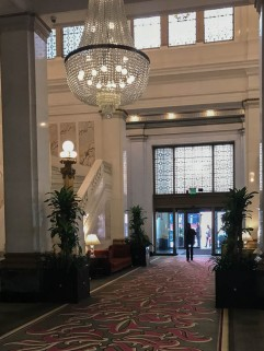 The magnificent lobby. Imported marble and Tiffany glass.