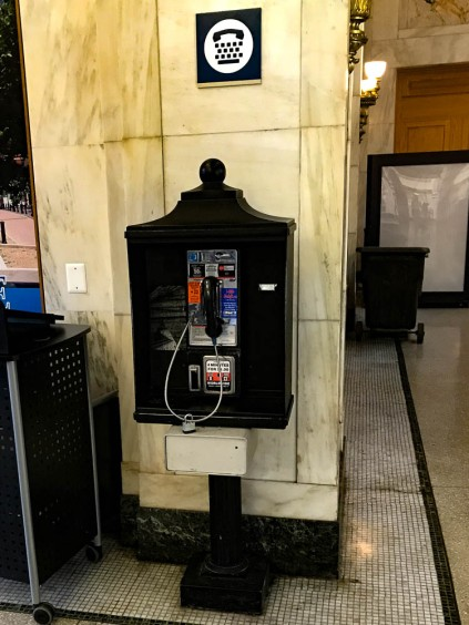Only one pay phone remains.