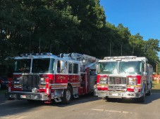 All the firemen are working the carnival, so they brought their rides and their gear.