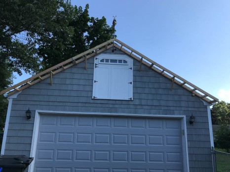 The angle braces are temporary, until the roof sheathing is extended.