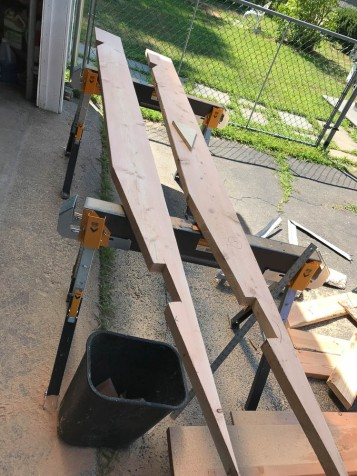 The rafter on the right was used as a template to cut the other 9 from 10' 2x8s.
