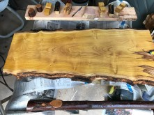 The first coat of oil has brought out the color of the slab.