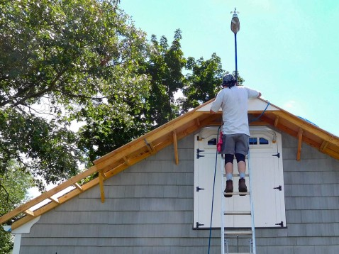 Taking the sheathing in place.