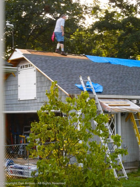 Once that tarp was removed, I had to install all the remaining shingles and the ridge vent.