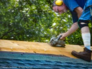 Cutting away a strip to serve as a ridge vent.