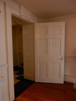 A 6-panel door inside a paneled door jamb.
