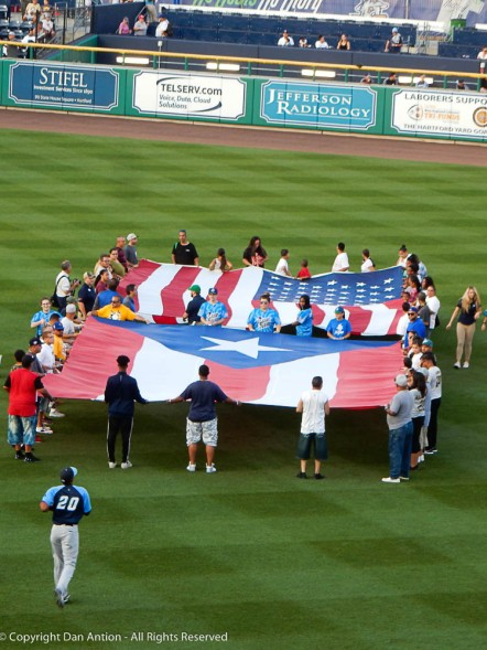 A lovely young woman sang both the Puerto Rico National Anthem and the US National Anthem.