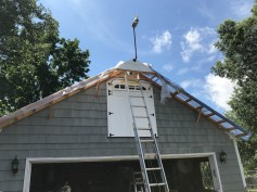 The trim boards are up in this small section. The weather station has been moved. Now the sheathing can be installed.