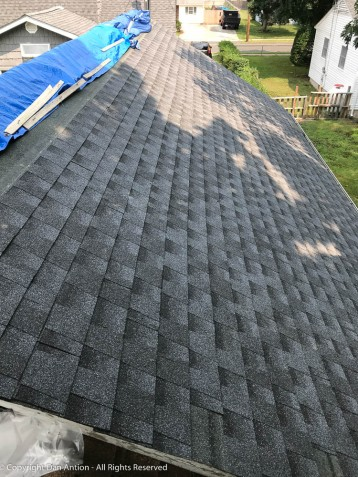 The east side is shingled as far up as I can go. The top course can't go on until I cut in for a ridge vent.