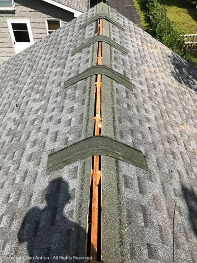 It looks like I'm at the top, but I have to bring the exposed part of the shingles up high enough to be covered by the ridge vent.