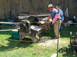 """Amazing operation. Sliding table saw. Approximate 30"""" blade, powered by a 2hp engine. Looks pretty dangerous, but worked like a charm."""