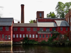 If you look closely, at the water level on the right and in the center, you can see the sluice gates that used to route water into the mill's waterwheels.