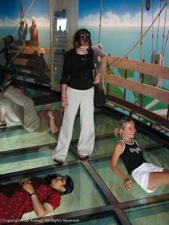 Faith looking through the glass floor.