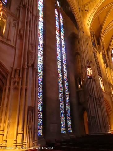 As you walk up the center aisle, the transept windows become visible.