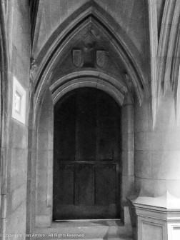 This door in in the side aisle near the alter.