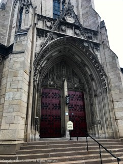 The seal of the University of Pittsburgh, is above the main entrance and is flanked by the seal of the City of Pittsburgh and the Commonwealth of Pennsylvania.