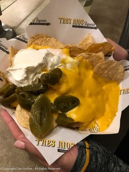 The guy opened new ingredients and put a little too much on Faith's nachos - she was OK with it.