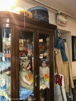 Hat box and antique dresses.