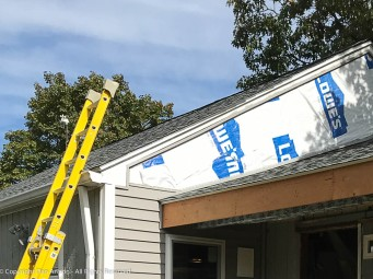 What appears to be the top two boards is really a single sheet of siding. It's a lot of cutting.