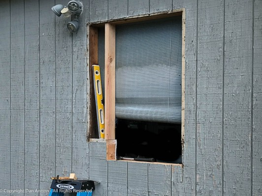 The old window is gone. Framing the new opening. I also have to replace that light fixture.