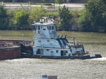 When I worked on the Gateway Party Liner, it was pushed by a tug like this one. Working the river.