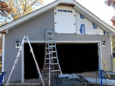 One pocket of siding left. Move the ladders and get back up there.