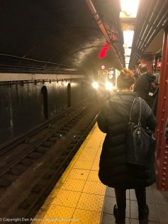The E-train is arriving. From 3rd and Lexington to Penn Station will be about 20 minutes.