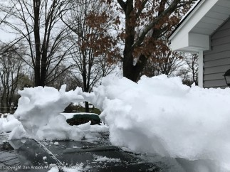 I'm not sure I've ever had to clean this much snow of The Editor's car. It's usually in the garage by now.