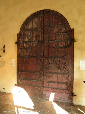This is the first set of doors that you see after walking through the entry cloister.