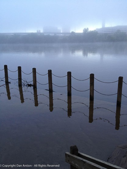 This is a flooded observation deck at Great River Park on a foggy day.