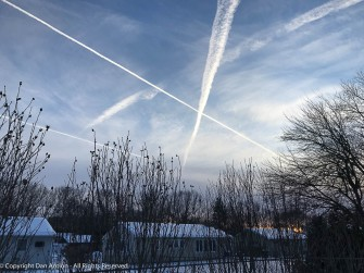 Crisscross contrails.