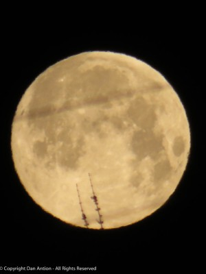 The moon is in focus. The blur is a power line and a bit of a tree.