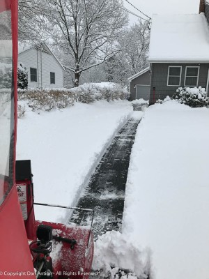 The first pass is the hardest. Now it's time to clear the end of the driveway.